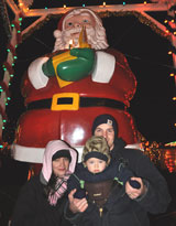 photo:  Scott, Laura, Liam with 15 foot Santa