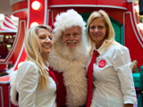 photo:  Santa and two pretty helpers
