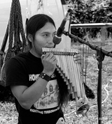 photo:  Man playing pan flute