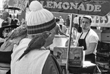 photo:  man with parrot at lemonade stand